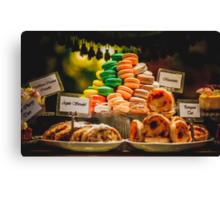 Macaroons piled up on a cake stand Canvas Print