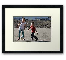 Playing football Framed Print