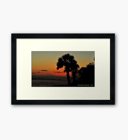 Sunset Behind The Clouds Framed Print