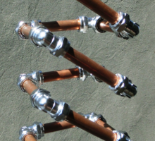 Copper and Chrome Slinki Tiki Torch - FredPereiraStudios.com_Page_25 Sticker