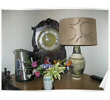 An Antique Clock and a Lamp Poster