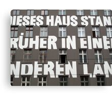 Capital letters writing on the facade of a Berlin building  Canvas Print