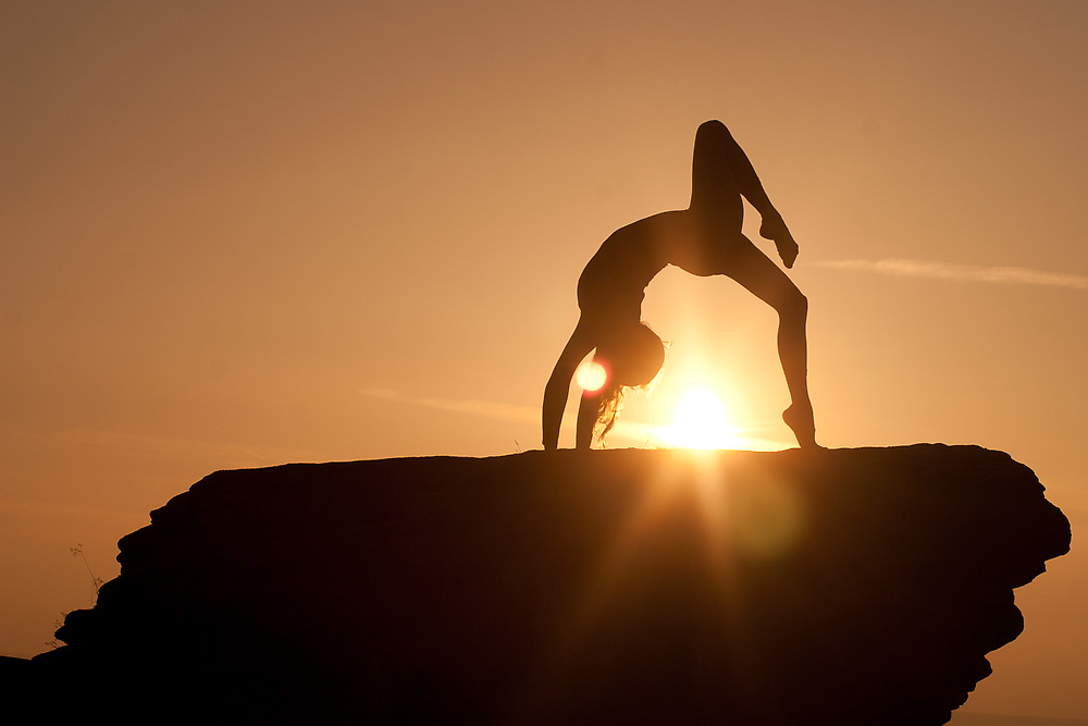 Yoga Poses at Sunset 2 by JonWHowson