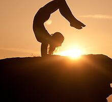 Yoga Poses at Sunset 5 by JonWHowson