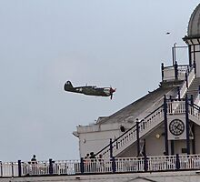 A spitfire flies over the pier at Eastbourne by Keith Larby