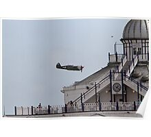A spitfire flies over the pier at Eastbourne Poster