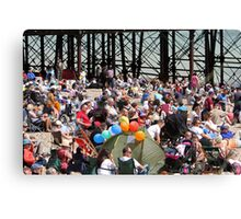 Crowds on the beach at Airbourne in Eastbourne Canvas Print