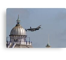 The Lancaster flies across the pier in Eastbourne Canvas Print