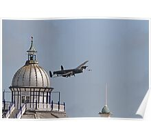 The Lancaster flies across the pier in Eastbourne Poster