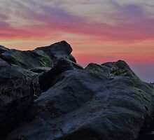 Happisburgh sea defences at sunset by Avril Harris