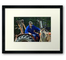 Farmer at work Framed Print