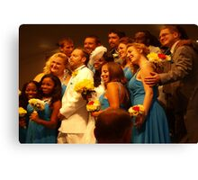 Exuberant wedding party Canvas Print