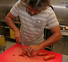 Omar Allibhoy chops chorizo sausages by Keith Larby