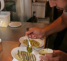 Omar Allibhoy prepares anchiovies at his restaurant Tapas Revolution by Keith Larby