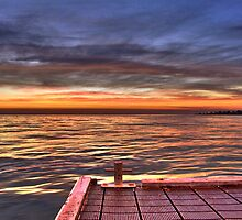 Sunrise on the pier by PhilMi