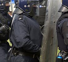Police in Riot Gear by Tom Curtis