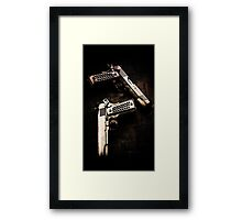 Guns Framed Print