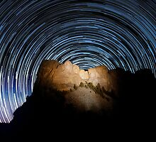 Stars trails over Mount Rushmore National Memorial by Alex Preiss