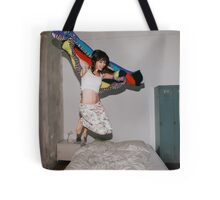 A Woman Jumping on Her Bed Tote Bag