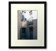 Blue Shutters on a Town House in Southern France Framed Print