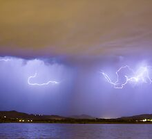 Lightning And Rain Over Rocky Mountain Foothills by Bo Insogna