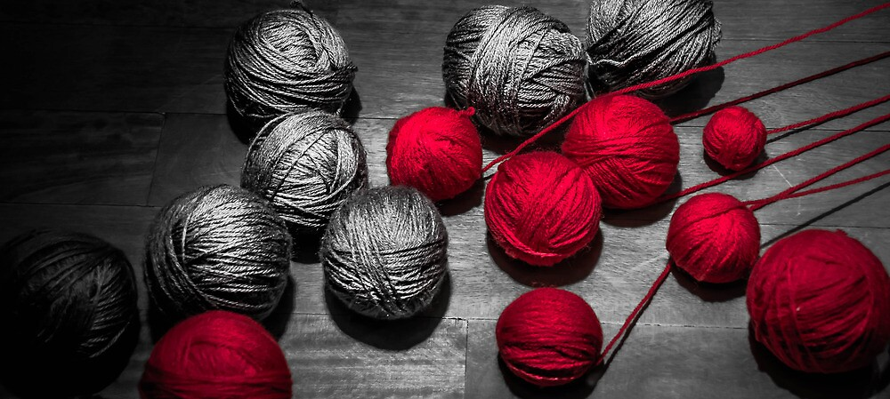 Red balls of thread by Sotiris Filippou