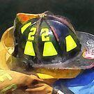 Fireman's Helmet on Uniform by Susan Savad