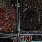 LoneTire in Back of Semi by Kim Krause