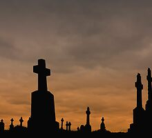 Crosses silhouettes against a colored cloudy sky by Gabrel