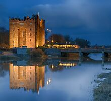bunratty castle durty nellys nellies at night water reflection county clare ireland by upthebanner