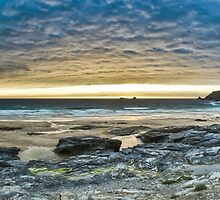 Sunset Over a Cornish Beach by pixog