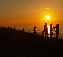 Silhouettes & Sunlight at Cley Beach by jamierickman