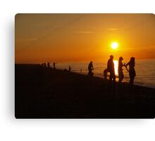 Silhouettes & Sunlight at Cley Beach Canvas Print