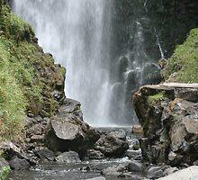 Peguche Falls Framed by Rocks by rhamm