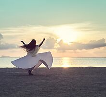 Woman Dancing on the Beach at Sunset by visualspectrum