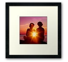 Lovers Watching a Romantic Sunset Framed Print