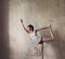 Yoga: Woman Performing Natarajasana by visualspectrum