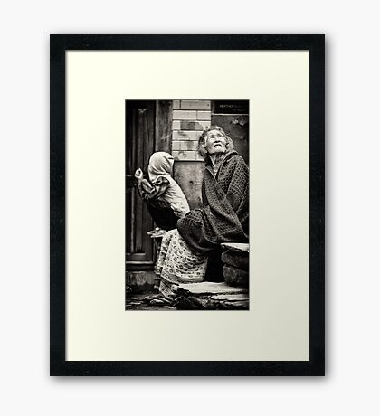 Old woman and child Framed Print