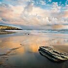 Cloud reflections and rock at Sunset by Heidi Stewart