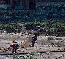 Fishermen hauling in nets Brindisi Harbour 198404030018 by Fred Mitchell