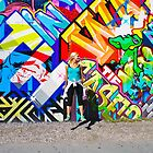 Jumping in front of the Bowery Mural. by Daniel Sorine
