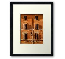 Italian terracotta painted building with shutters. Framed Print