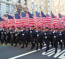 Firemen marching with American Flags by Danny  Daly