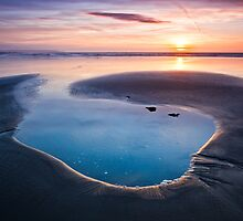 Sunset on the beach at Westward Ho! by Heidi Stewart