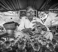 Jaipur market perfume oil seller by Heather Buckley
