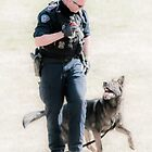 Working Hard - Police Dog & His Handler by Daphne Eze