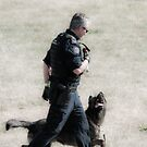 Paying Attention - Police Dog & His Handler by Daphne Eze
