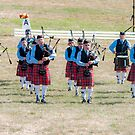 Marching Together - A Bagpipe Band by Daphne Eze