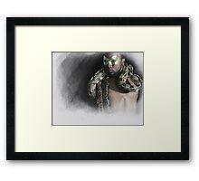 The man....the snake Framed Print
