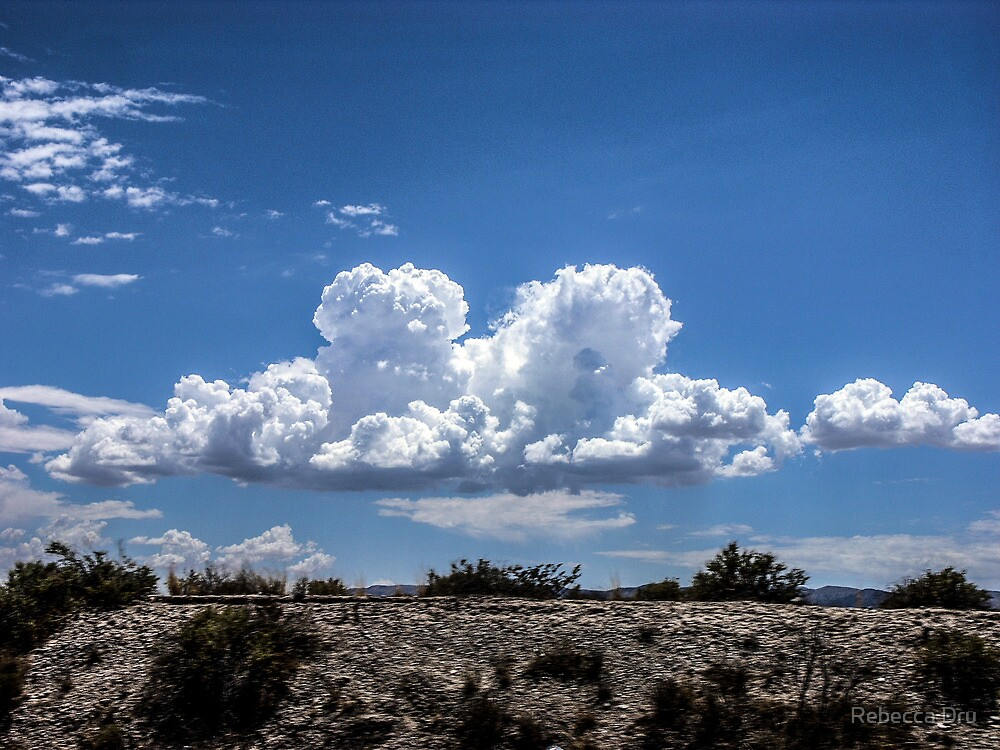 View from the road of amazing clouds by Rebecca Dru